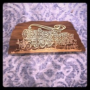 Carved train wall decor